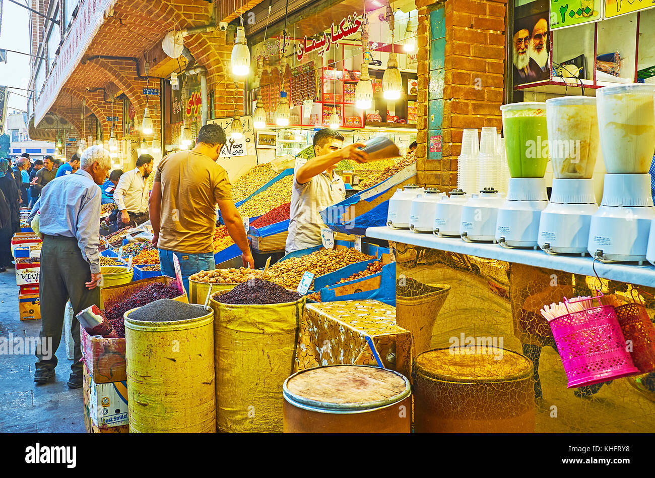 TEHRAN, IRAN - OCTOBER 11, 2017: The  stall of confectionaries, dry fruits and nuts is neighboring with the fruit - Stock Image
