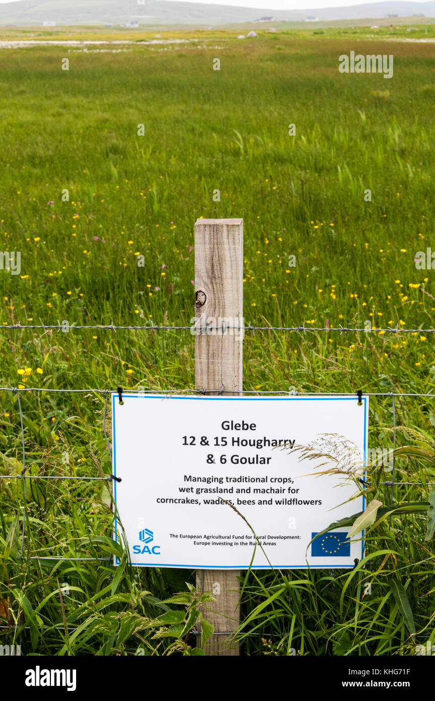 A sign on North Uist in the Outer Hebrides records investment by European Agricultural Fund for Rural Development - Stock Image