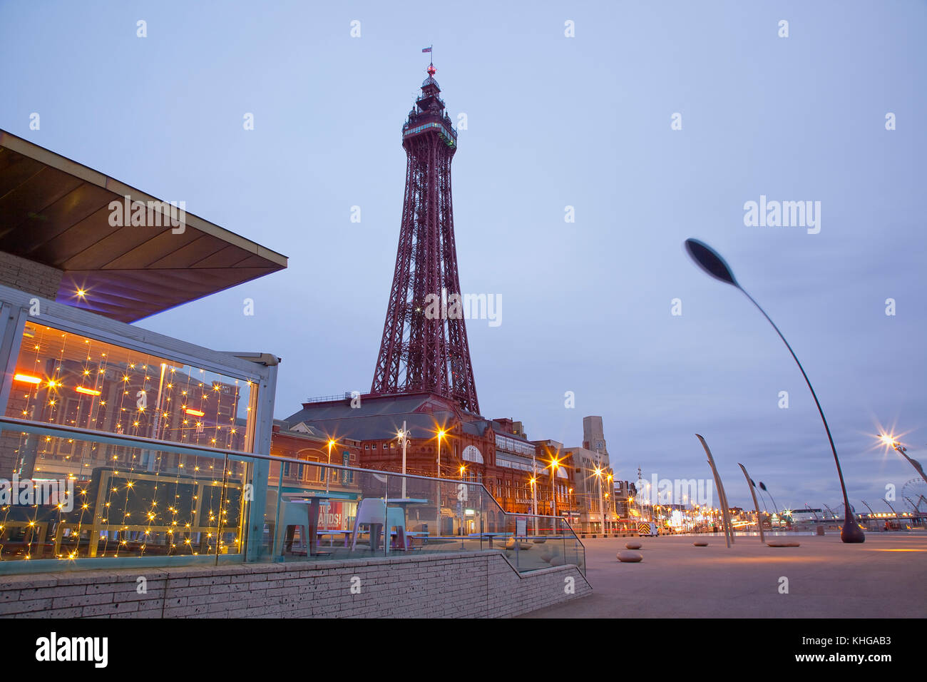 England, Lancashire, Blackpool, Seafront promenade with Tower at dusk. - Stock Image