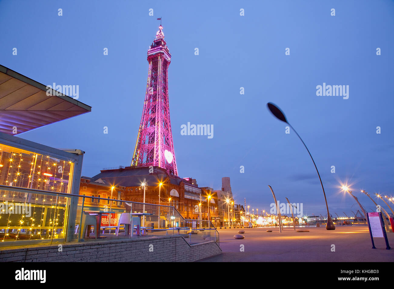 England, Lancashire, Blackpool, Seafront promenade with Tower illuminated at dusk. Stock Photo