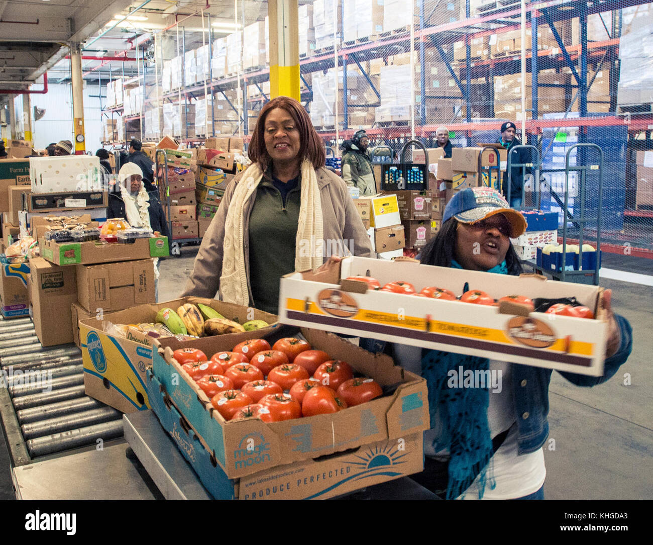 Cathedral International Soup Kitchenu0027s Geneva Evans, Is Helped By Community  FoodBank Of New Jerseyu0027s Tamesha Brown (wearing Cap), Weighs And Records  Produce ...