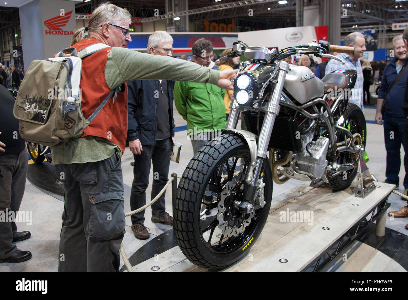 People checking out the brand new CCM Spitfire cafe racer at