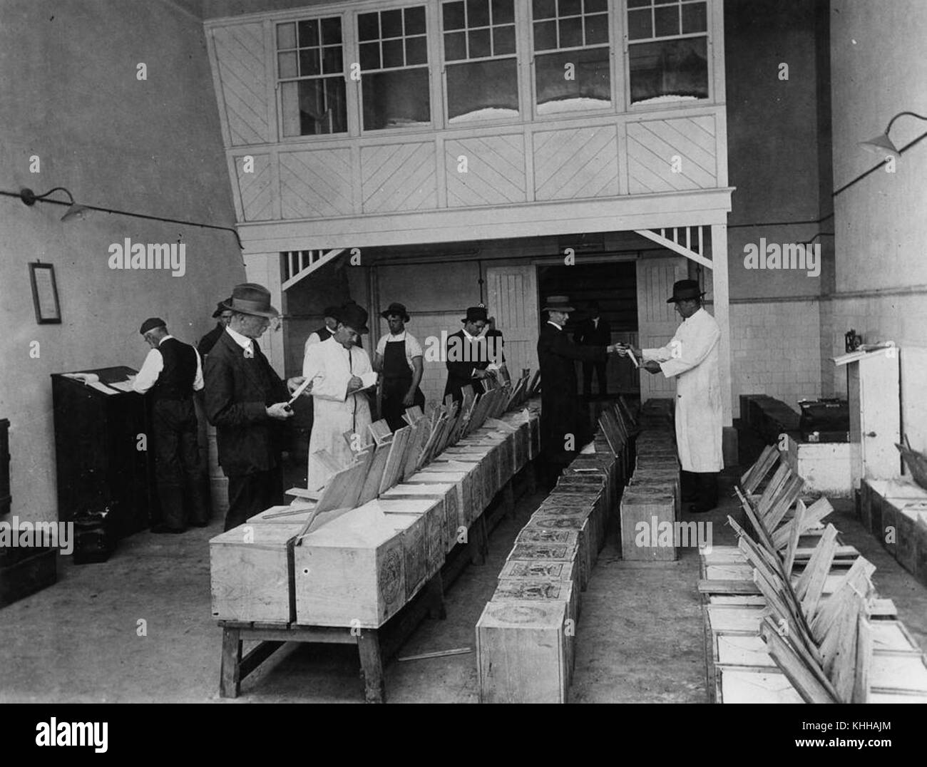 1 67939 Grading butter at the railway cold stores Roma Street Brisbane ca. 1917 & 1 67939 Grading butter at the railway cold stores Roma Street Stock ...