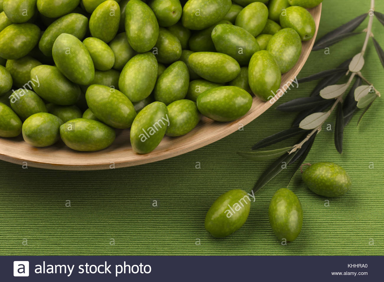 Unprocessed, green, Italian olives harvested in autumn. Olives are a staple of the Mediterranean diet. - Stock Image