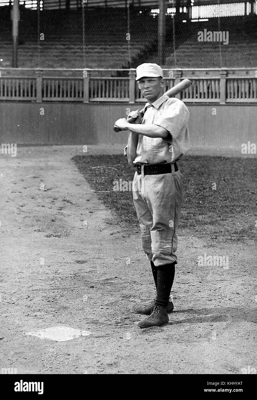 A full length portrait photograph of Denny Lyons, he is wearing a baseball uniform and holding a bat, he played - Stock Image
