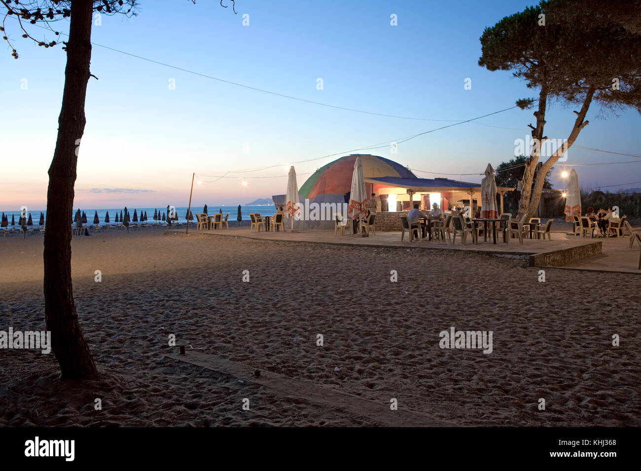 Converted Cold War bunker converted into a bar on the beach at Mali i Robit, Albanian. - Stock Image