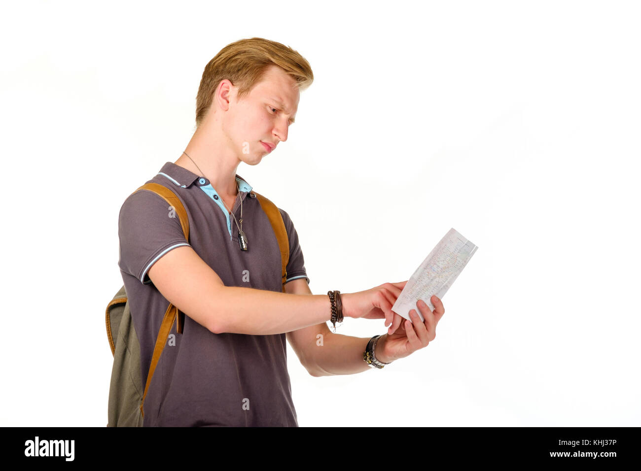 Young man traveler looking for a destination with map Stock Photo
