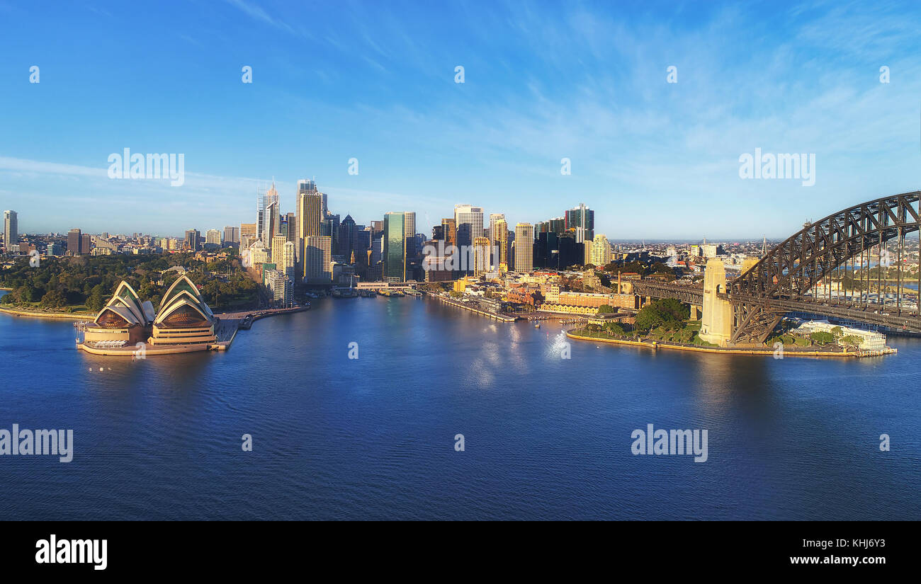 Landmarks of Sydney city CBD on Harbour waterfront around Circular Quay with arch of the Sydney Harbour bridge in - Stock Image