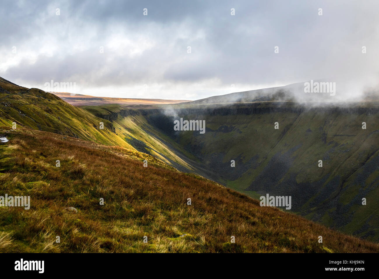 Swirling Clouds and High Cup Nick from the Pennine Way Footpath, Cumbria, UK - Stock Image