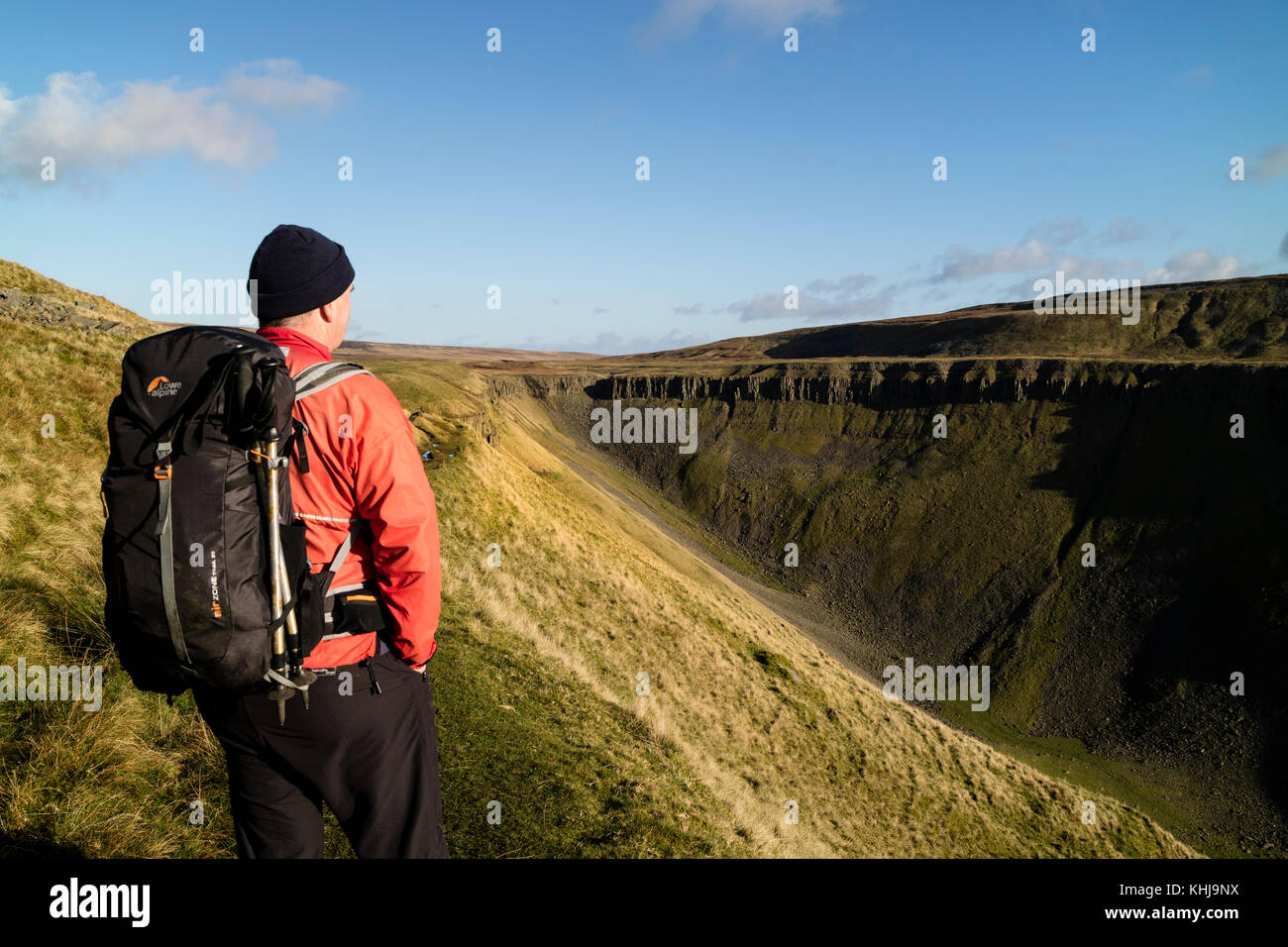 Hiker Viewing High Cup Nick from the Pennine Way, Cumbria, UK	 - Stock Image