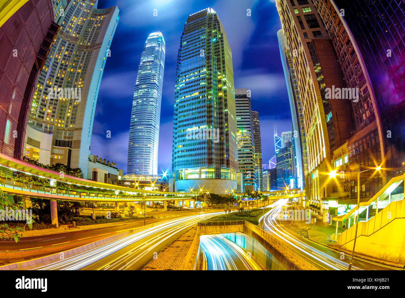 night view of Hong Kong with traffic trails Stock Photo