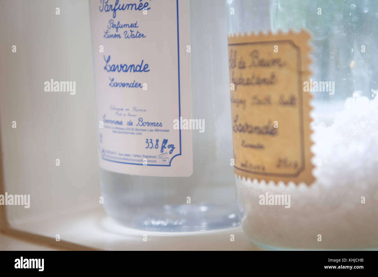 Two Old Fashioned Bottles Of Lavande Adorn A Shelf In A Bathroom In