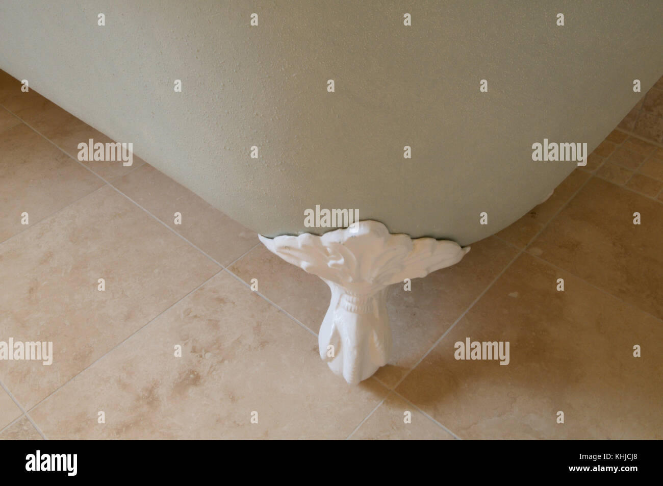A corner foot of an old claw foot bathtub. - Stock Image