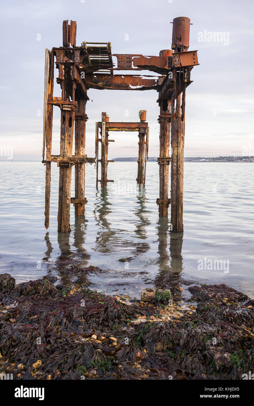 Remains of World War II D-Day embarkation pier, also known as 'Dolphins' on The Solent at Lepe Country Park, - Stock Image