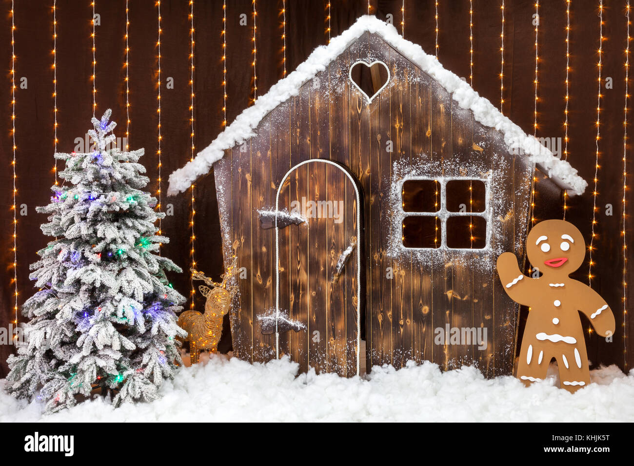 a new year scene with a snow covered wooden hut a gingerbread man and