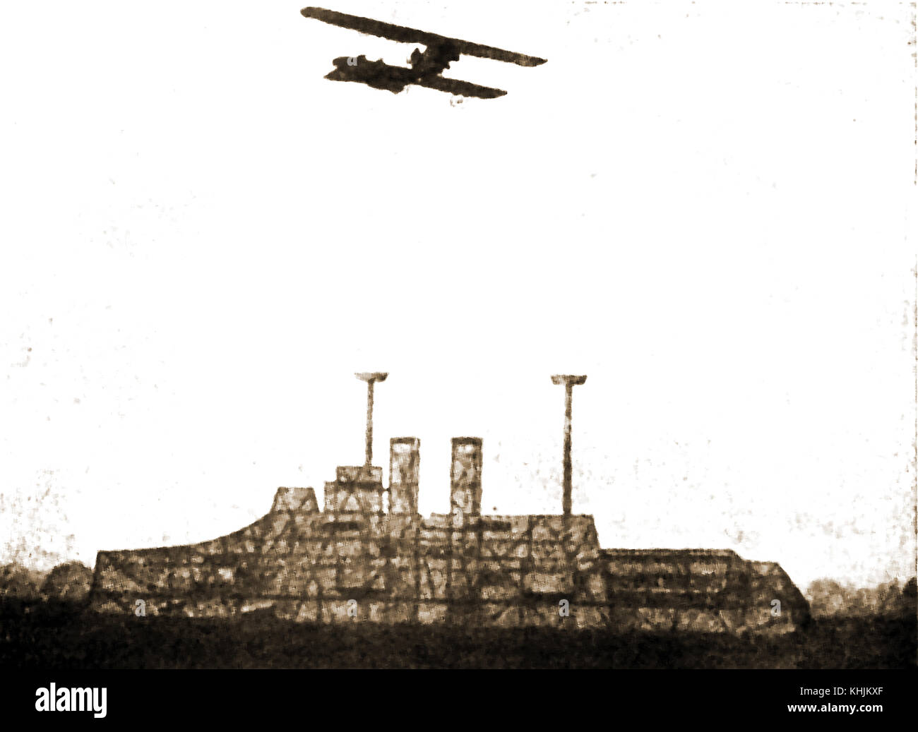 WWI  A German biplane practising bomb dropping on a wooden mock-up of a British Dreadnought battleship (From a German Stock Photo