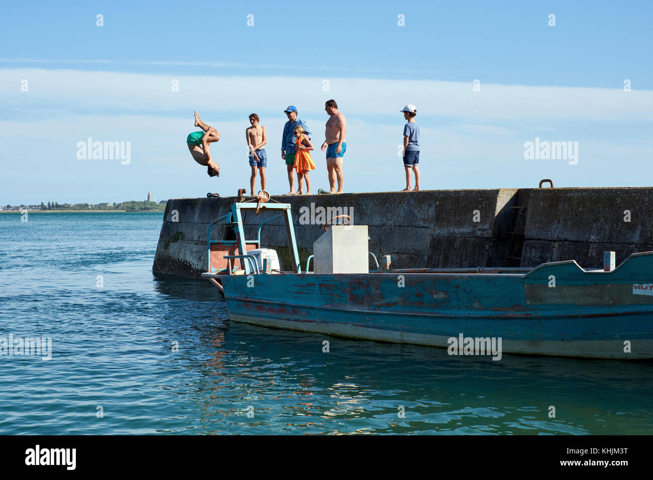 Acrobatic somersaulting fun in the sea at Le Croisic on the Guerande Peninsula in the Loire-Atlantic region of Brittany Stock Photo