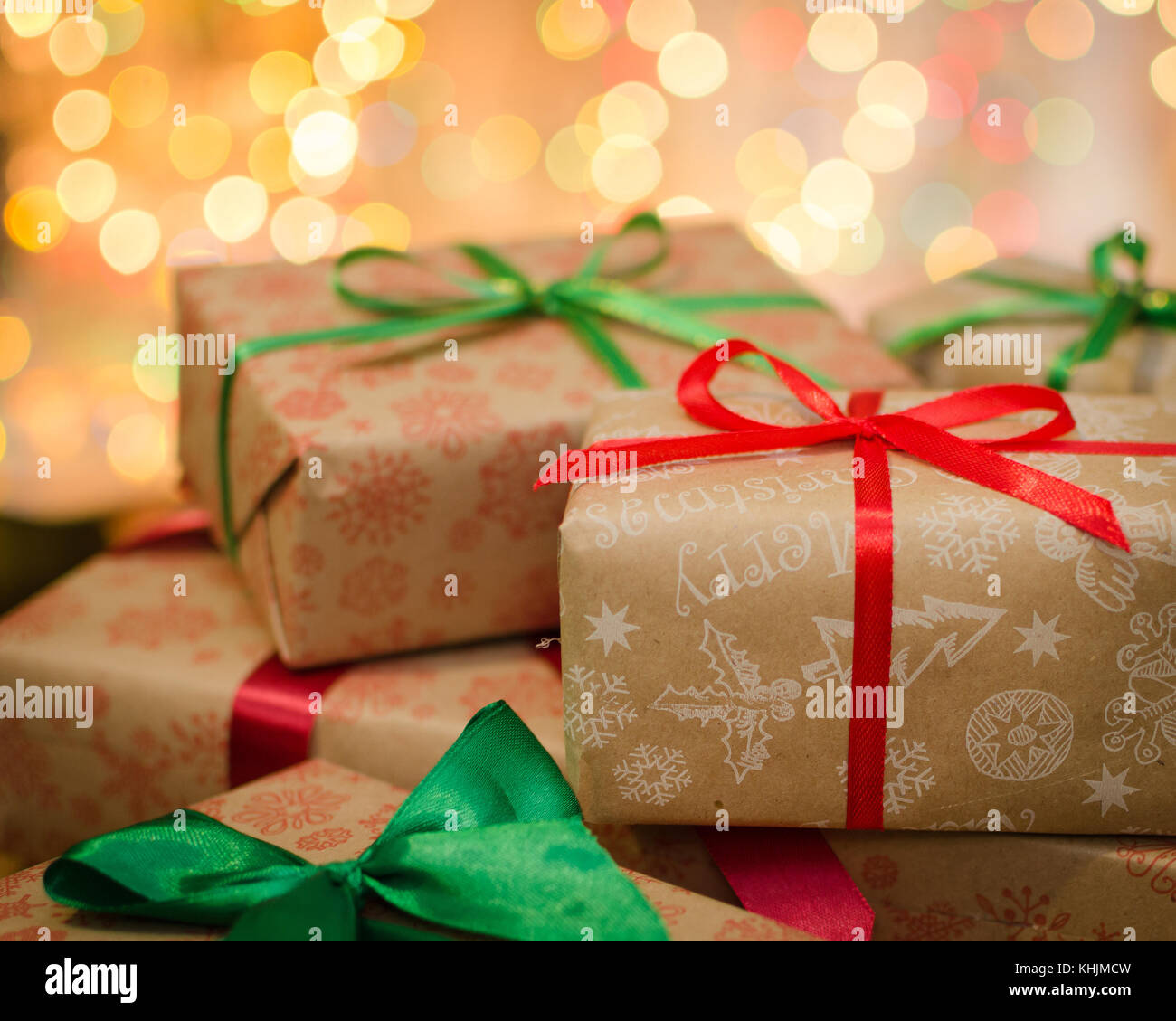 Christmas Gift Boxes Wrapped In Themed Craft Paper And Satin