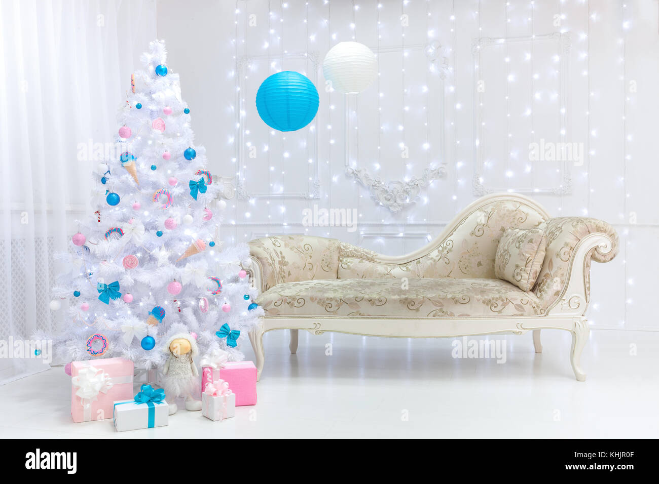 Classic Christmas light interior in white, pink and blue tones with ...
