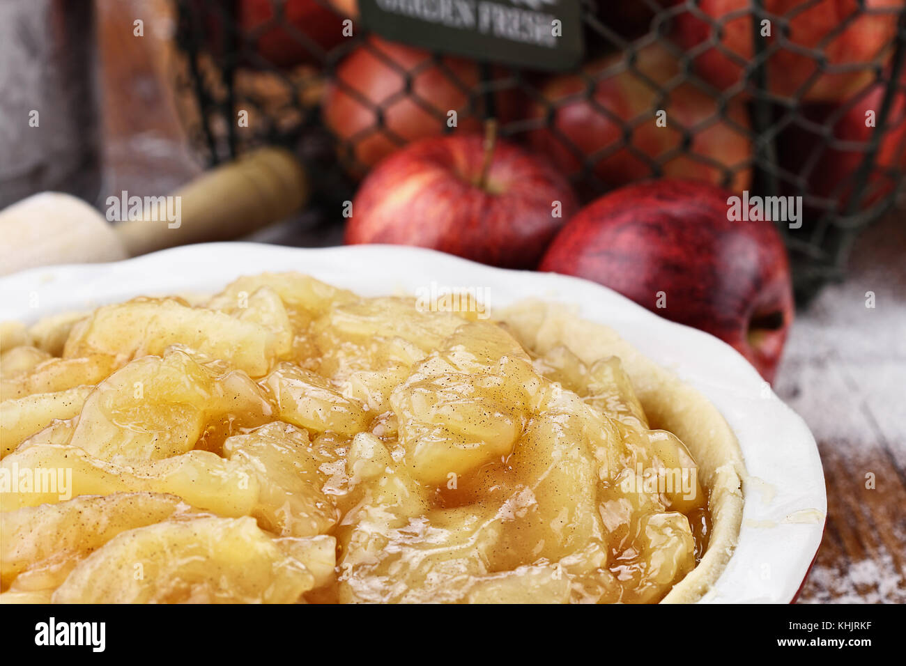 Apple pie filling in homemade pie shell. Extreme shallow depth of field with selective focus. - Stock Image