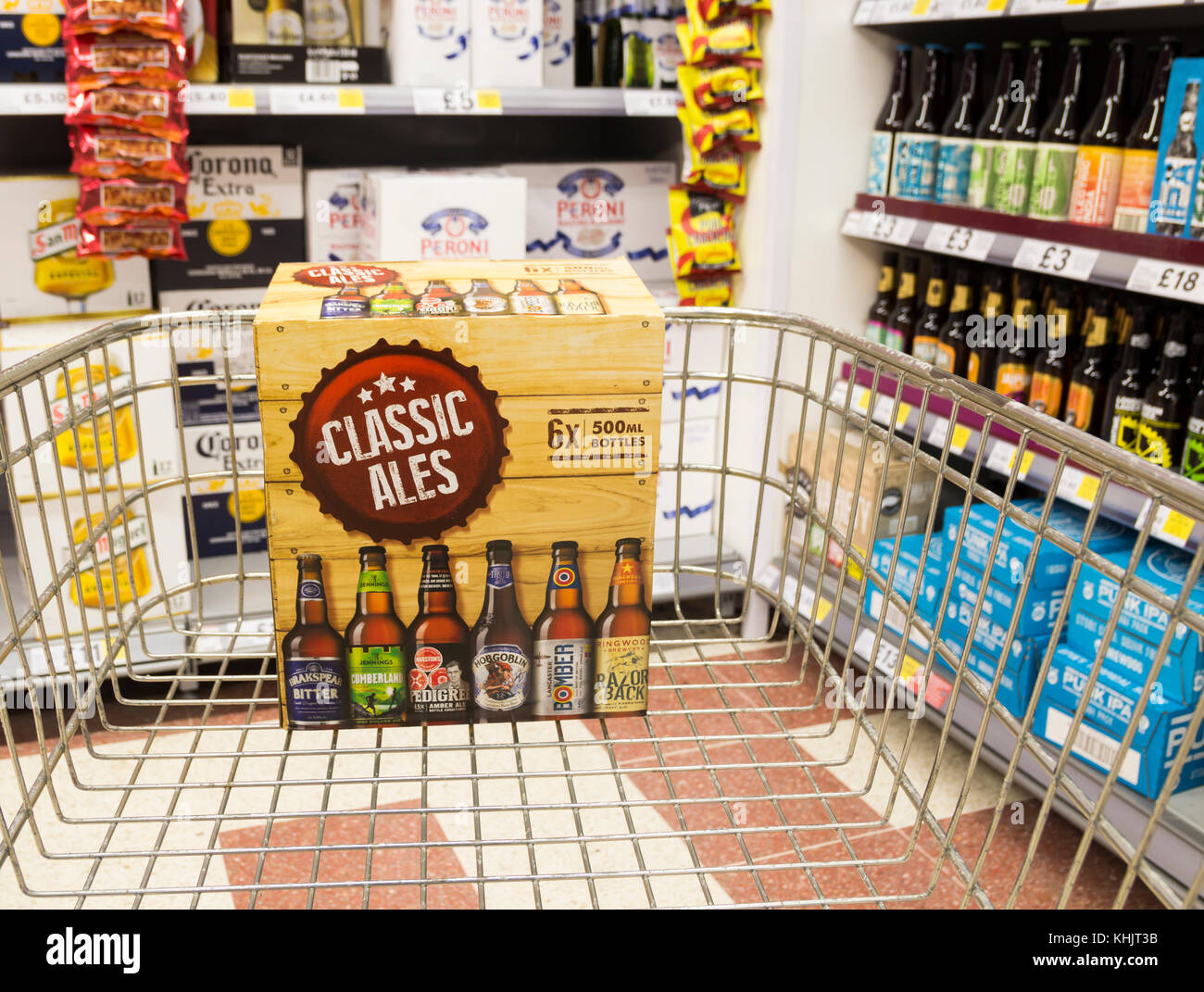 Craft beer/Classic Ales in supermarket trolley in Tesco supermarket .UK - Stock Image