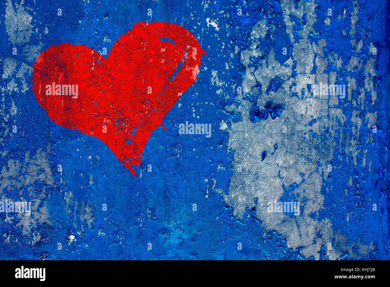 Red Heart Painted Over Grunge And Old Weathered Dark Blue