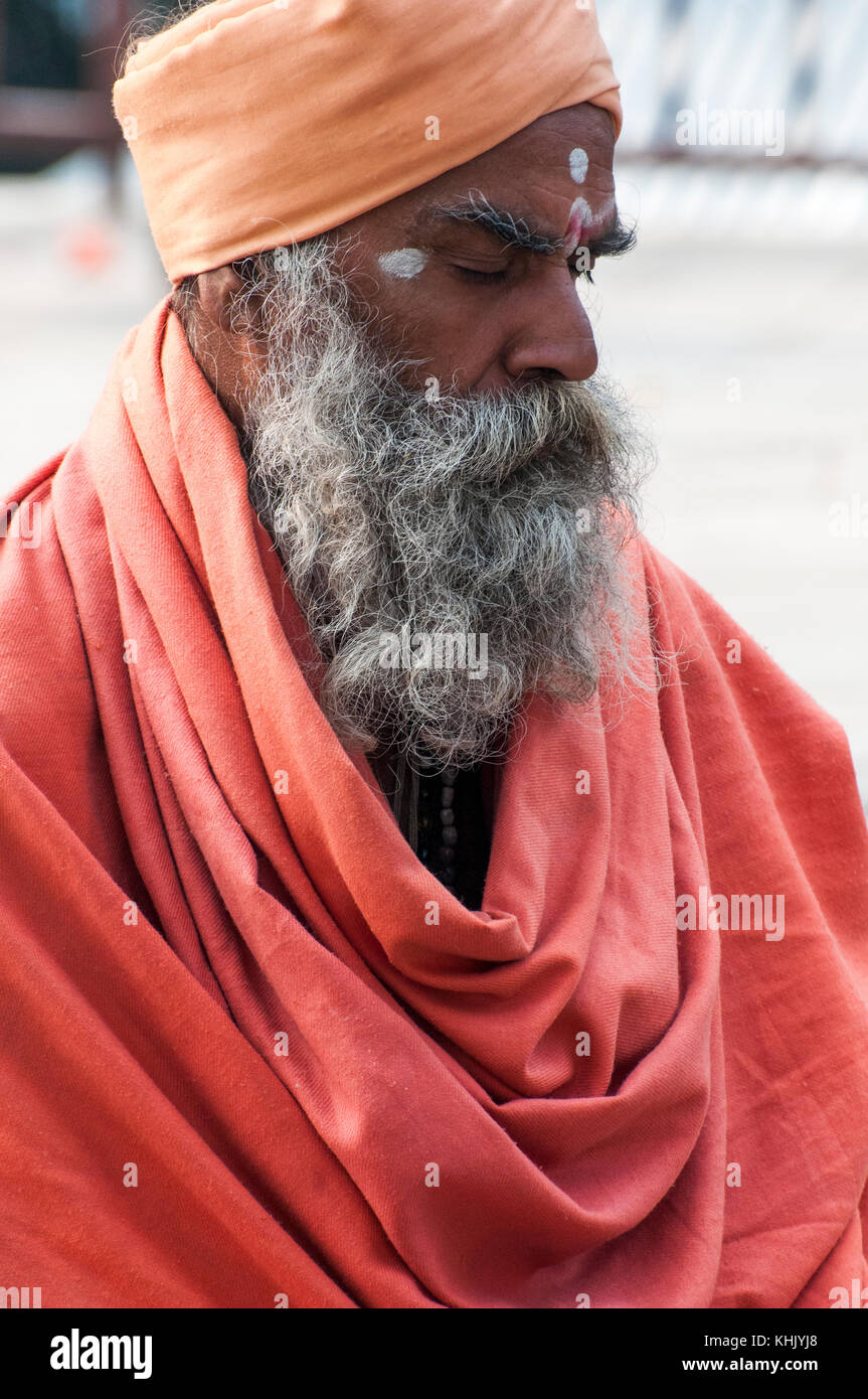 Sadhu (a Hindu elder, preacher or holy man) at a temple in Pokhara, Nepal - Stock Image