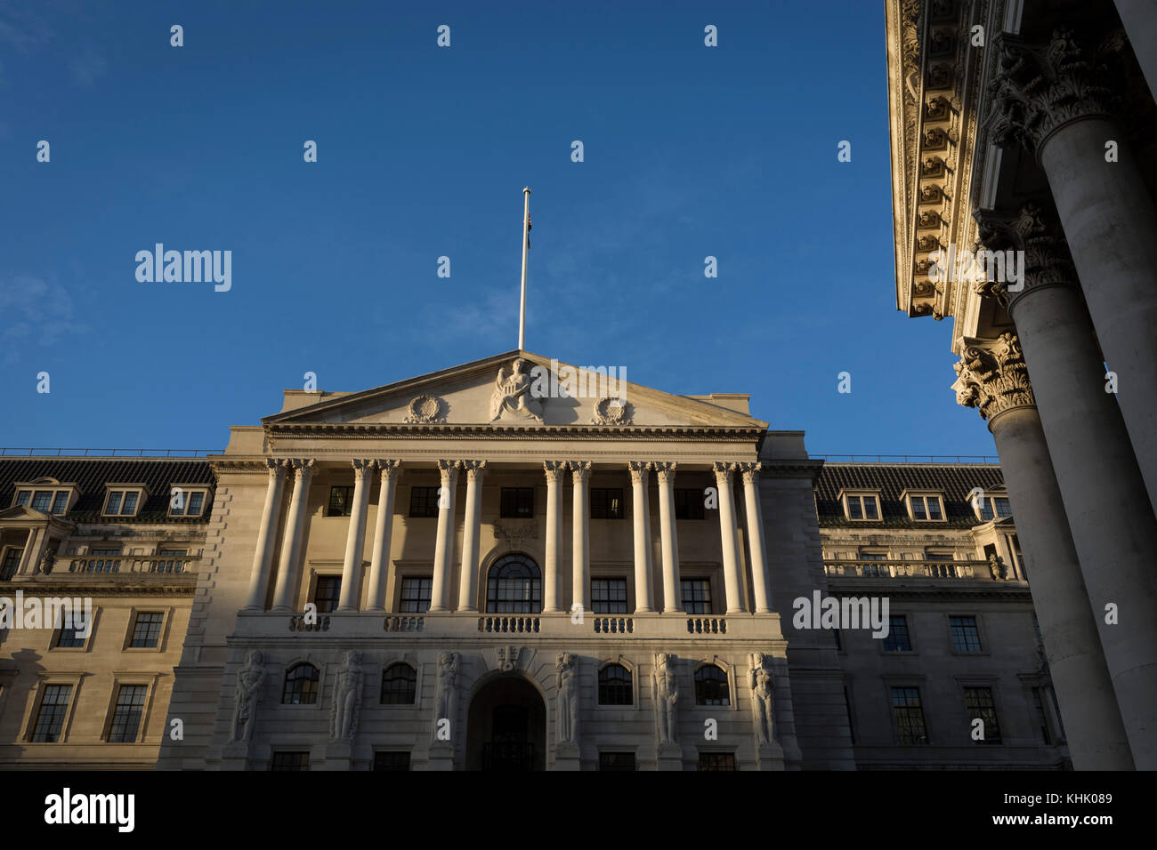 Exterior of the Bank of England and the Corinthian columns of Royal Exchange on Threadneedle Street in the Square - Stock Image