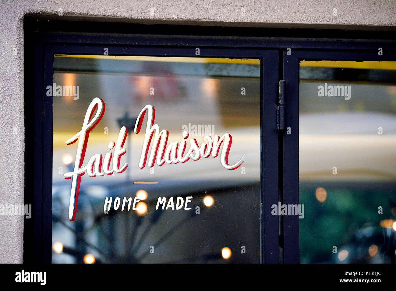 Home made cooking sign on a Shop Window of a restaurant, Paris 9th, France - Stock Image