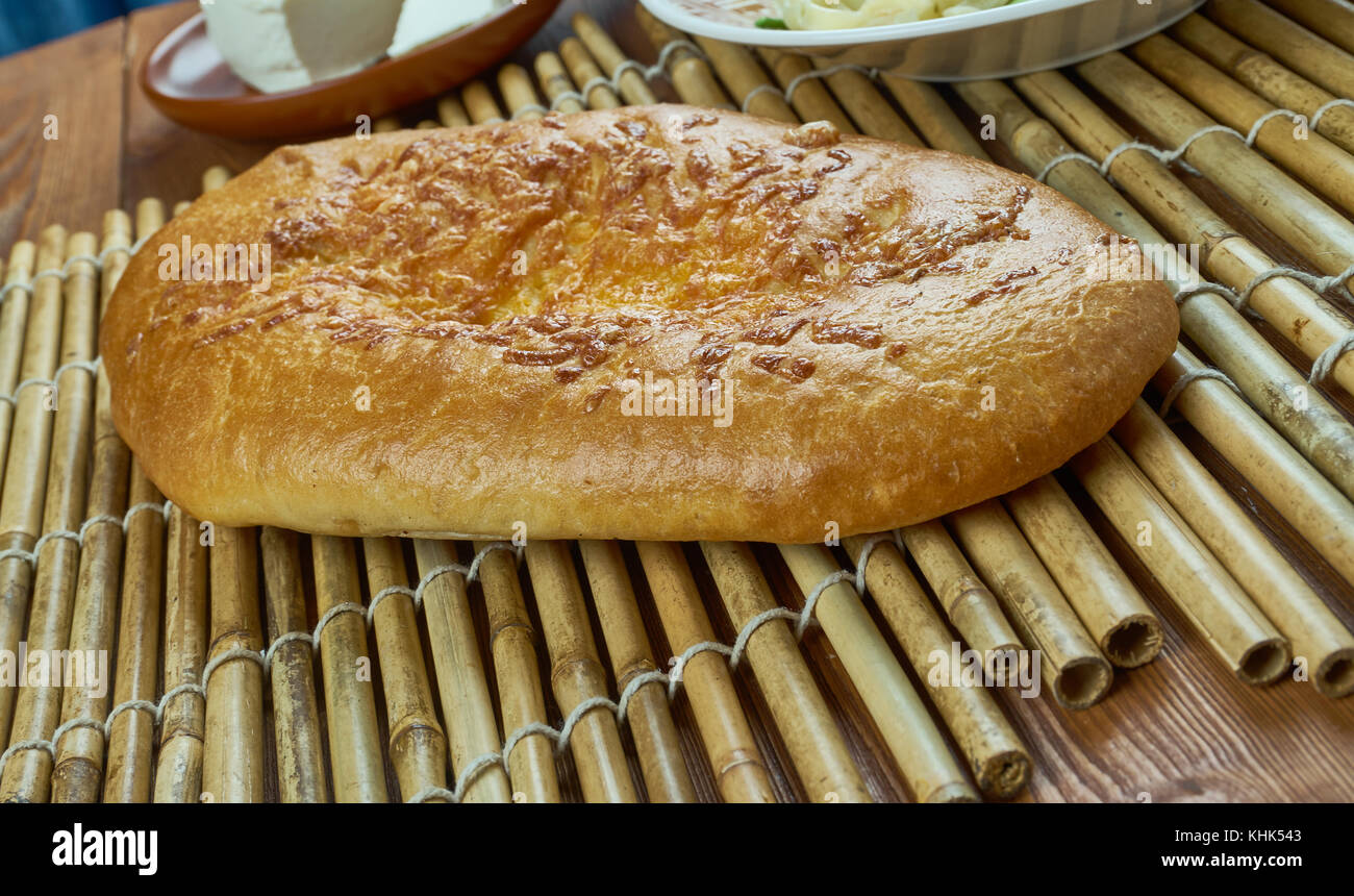 Ossetian homemade cheese pie , close up - Stock Image