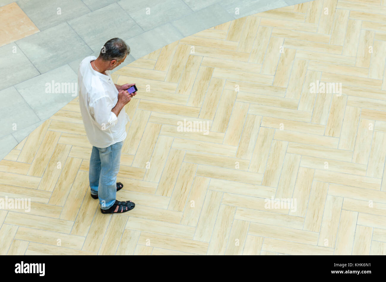 Top view of Full length of man with smart phone, Always connected concept - Stock Image