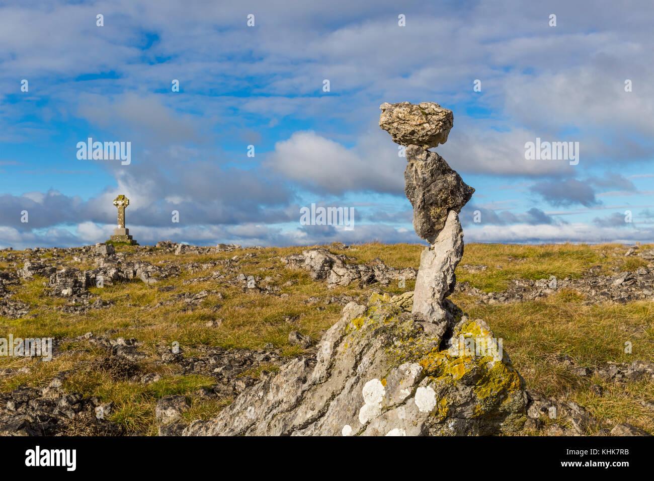Limestone Rocks Carefully Balanced on Top of Beacon Hill near Orton in Cumbria, England, UK. - Stock Image