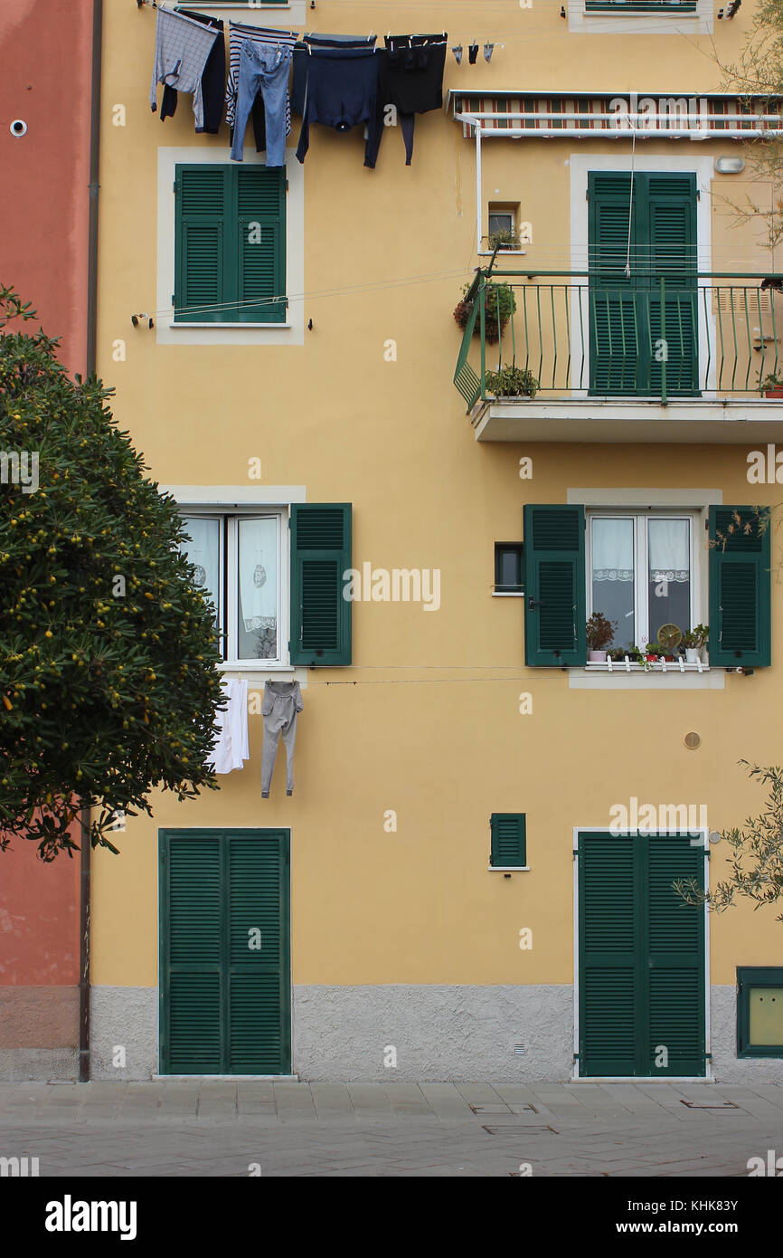 beautifully colored facade of typical houses in Liguria, Italy - Stock Image