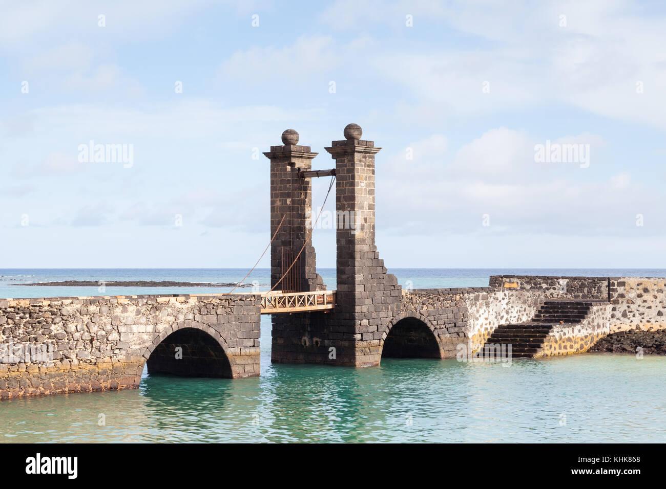 Bridge of the Balls.  Puente de las Bolas leads to San Gabriel Castle in the port city of Arrecife on the Spanish Stock Photo