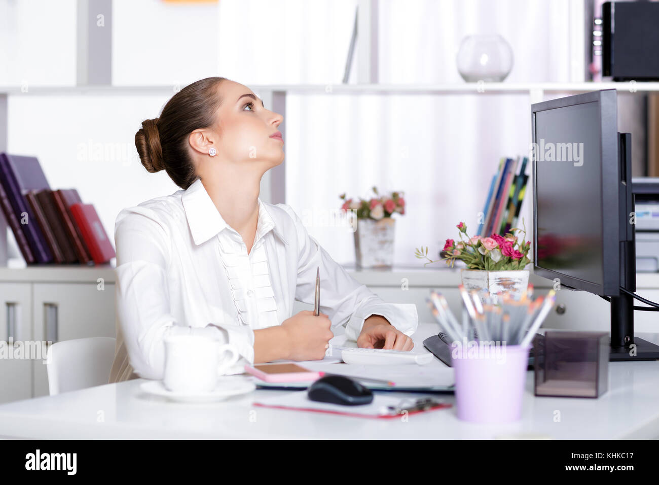 tired woman manager in the office - Stock Image
