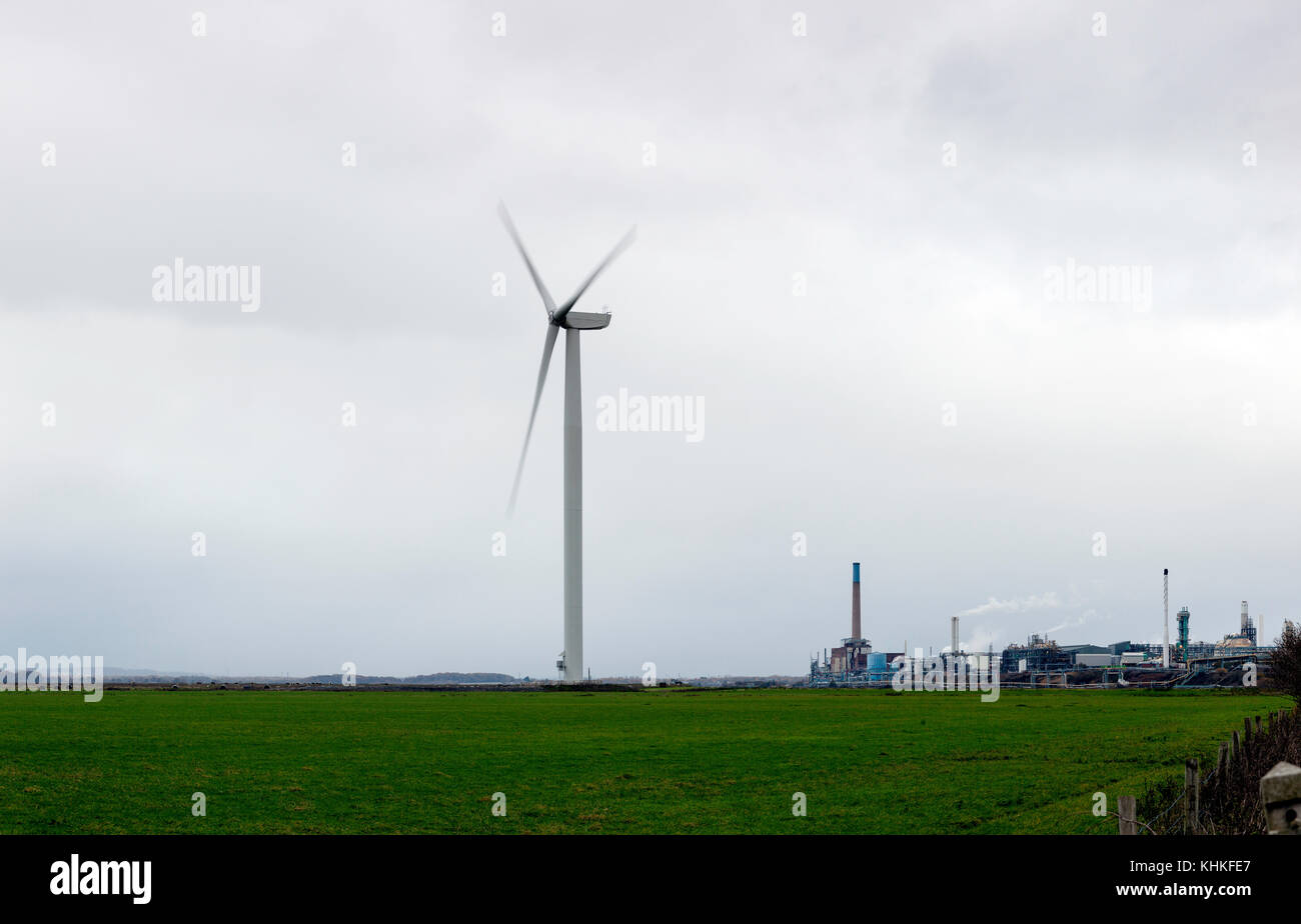 A wind turbine standing alone within an industrial landscape,Frodsham,Cheshire,England,United Kingdom - Stock Image