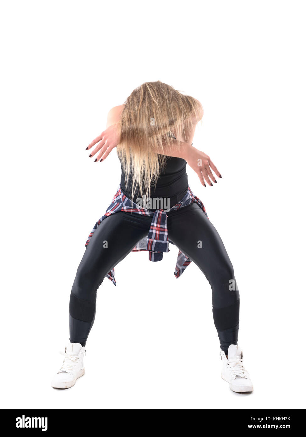 Passionate woman jazz dancer raising up with hair over her hands and head. Full body length portrait isolated on - Stock Image