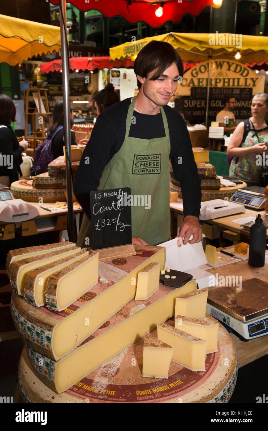 UK, London, Southwark, Borough Market, Italian Comte cheeses on sale at Borough Cheese company stall - Stock Image