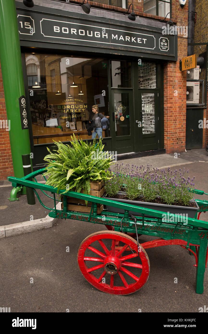 UK, London, Southwark, Borough Market, floral barrow outside market office - Stock Image