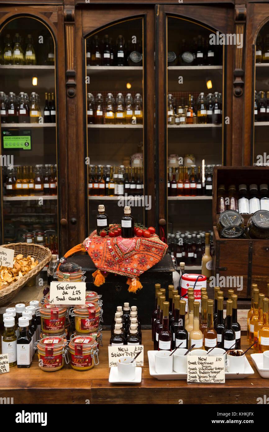 UK, London, Southwark, Borough Market, Three Crown Square, Fitz fine food stall, goods displayed on antique furniture - Stock Image