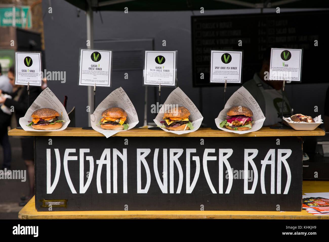 UK, London, Southwark, Borough Market, hot food stall, Vegan Burger Bar, different burgers on display - Stock Image