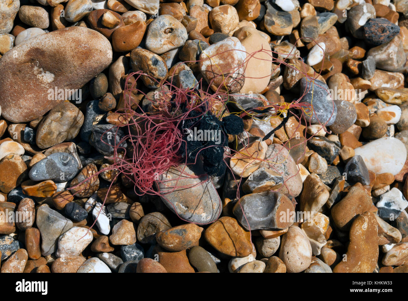 Washed up fishing line on the beach - Stock Image