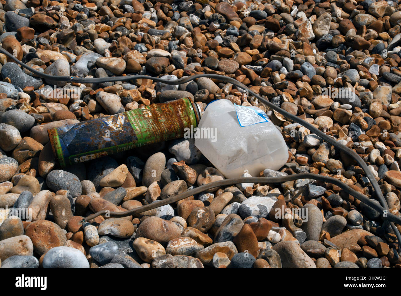 Washed up rubbish on the beach - Stock Image