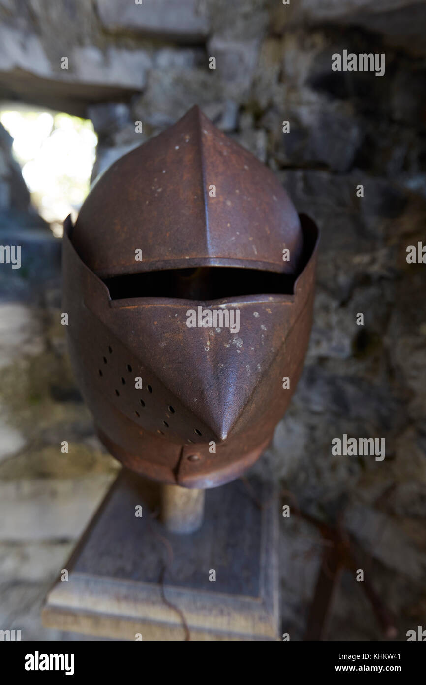 Suite of armour on display in Castello di Vezio watchtower, Varenna, Lecco Lombardy, Italy. - Stock Image