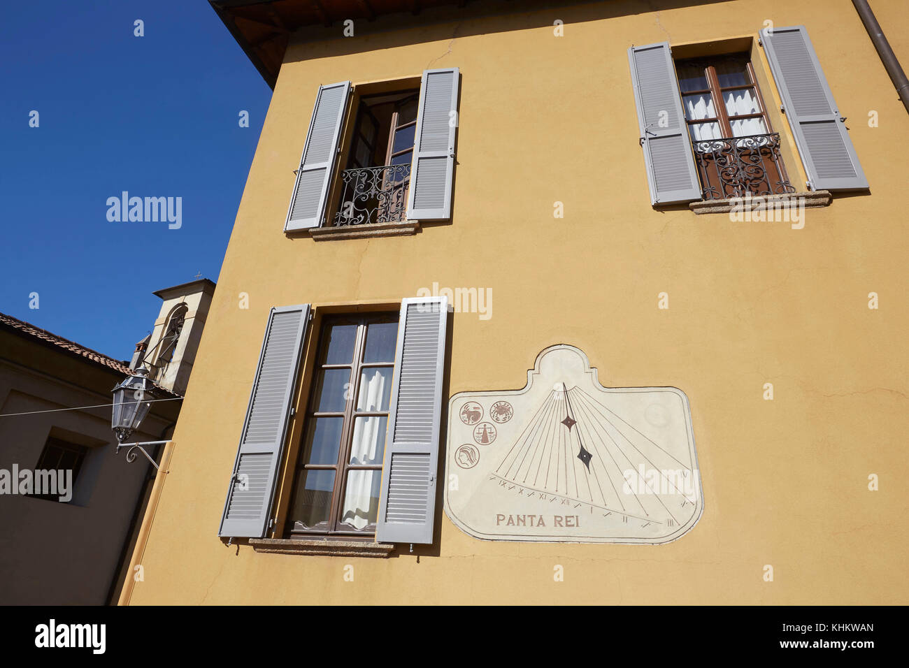 Sun dial and shutters on a villa, Varenna, Lake (Lago) Como, Lecco Lombardy, Italy. - Stock Image