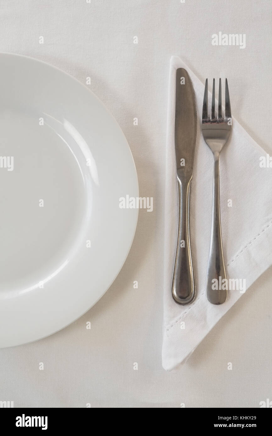 Close-up of white plate and cutlery set on a table - Stock Image & Cutlery Set Pink Ribbon On Stock Photos u0026 Cutlery Set Pink Ribbon On ...