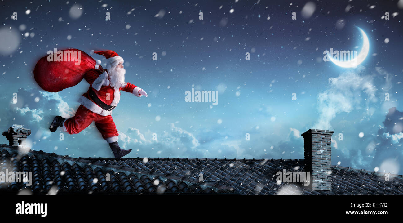 Santa Claus Running On The Rooftops - Stock Image