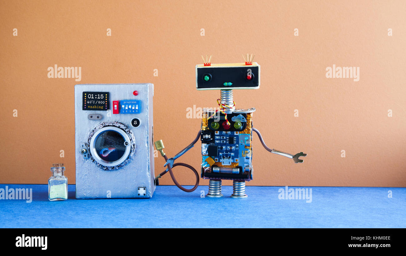 Washing machine laundry concept. Robot house master on brown wall interior, blue floor. Funny toys creative design. - Stock Image