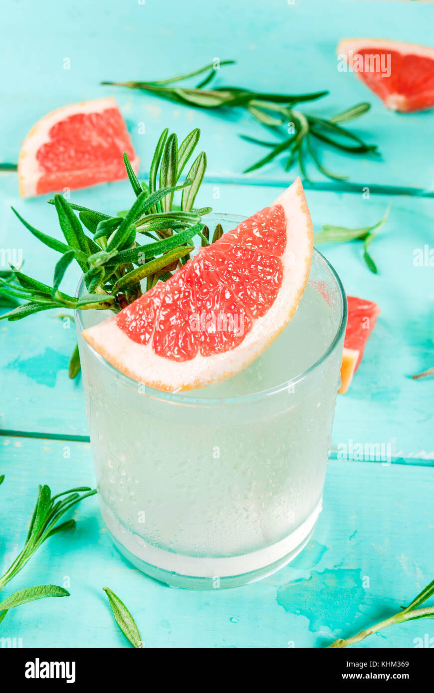 Alcohol drink, Rosemary, Grapefruit & Gin Cocktail, On light blue wooden table background, copy space - Stock Image