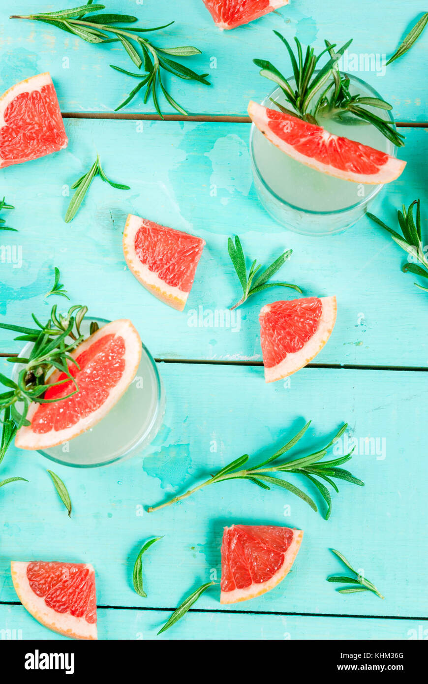Alcohol drink, Rosemary, Grapefruit & Gin Cocktail, On light blue wooden table background, copy space top view - Stock Image